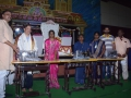 Sathguru Presenting Sewing Machines to Needies along with V.V.Lakshmi Narayana