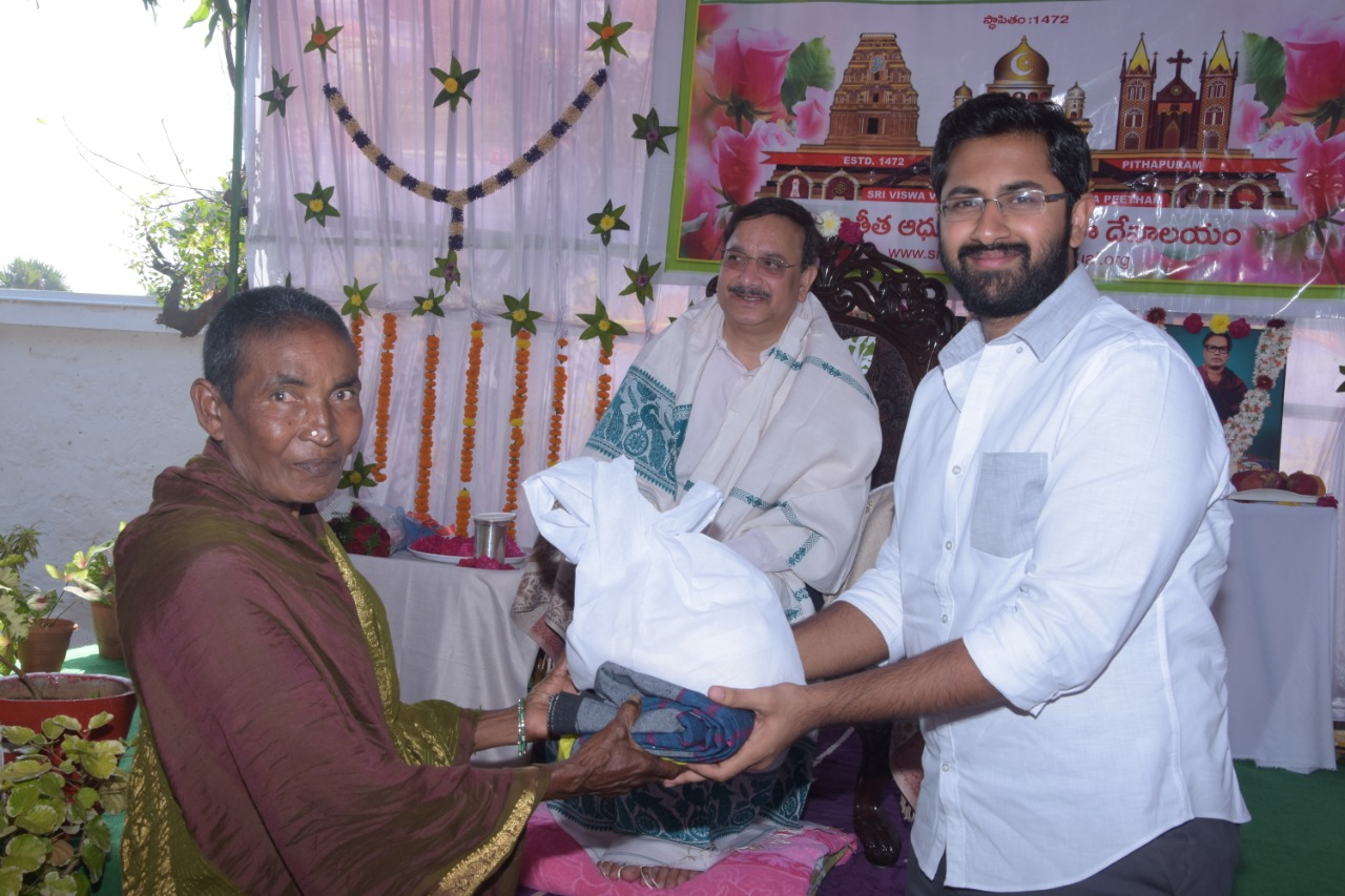 Sri M.Bharat (Geetham Institutes Chairman, Vishakapatnam) distributing saree and rice to poor women  on the occasion of 18thAnniversary of Bheemili Ashram