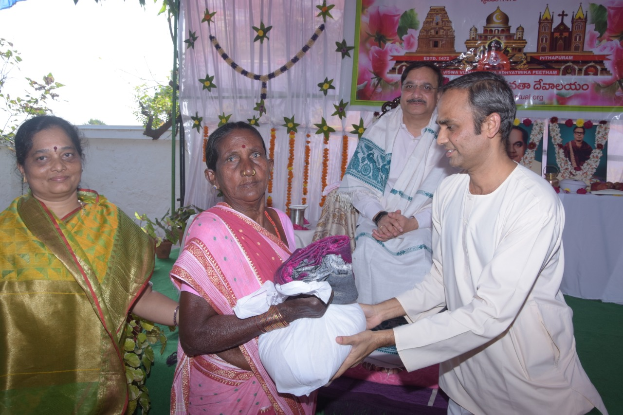 Sri S V Satyanarayana , Vedhantha Institute chairman (Vishakapatnam ) distributing saree and rice to poor women  on the occasion of 18thAnniversary of Bheemili Ashram