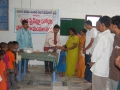 Dr. Umar Alisha, Chairman UARDT, giving Swine Flu preventive medicine to a child at Pithapuram on 27-Aug-2009