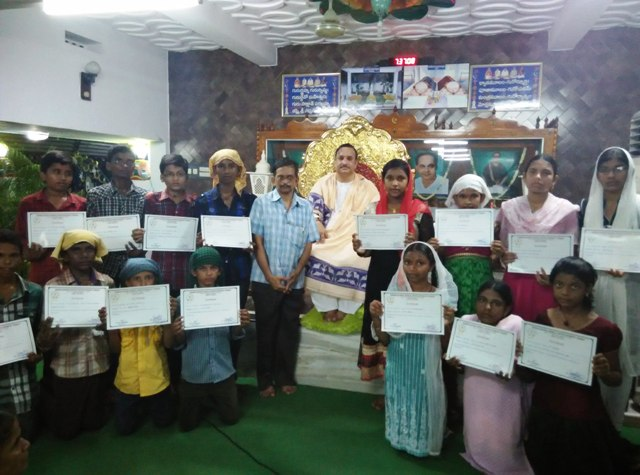 Dr Umar Alisha has given away certificates to the students who have successfully passed in the Basic Computer Course which was offered to students from 5-5-2015 to 19-5-2015