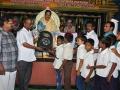 Dr.Umar Alisha, UARDT chairman, distributing school bags to 125 students ( 3rd class to 10th class)of R.R.BH.R BC boys hostel pithapuram on the occasion of Guru Pournami at Sri Viswa Vizanan Aadhyatmika Peetham new Ashram Premises