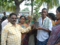 150 plants were distributed , members showing the plant they received on the occasion of Guru Pournami