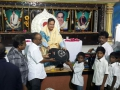 Dr.Umar Alisha, UARDT chairman, distributing school bags to 125 students of R.R.BH.R BC boys hostel pithapuram on the occasion of Guru Pournami at Sri Viswa Vizanan Aadhyatmika Peetham new Ashram Premises