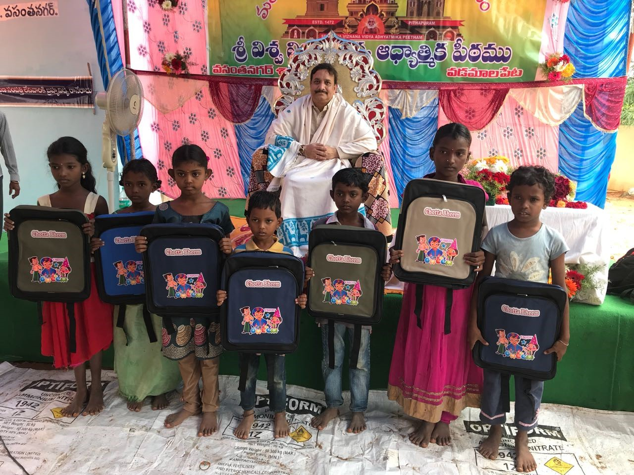 Blankets and Schoolbags Distribution by Dr Umar Alisha at RamarajuKandrika, Vadamalapeta Mandal, Chittoor