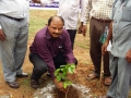 World Environment Day  Rally - DFO Sri AVSRK Appanna planting a sapling at Kakinada Ashram.