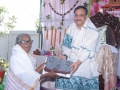 Dr.Umar Alisha distributing saree to poor women  on the occasion of 18thAnniversary of Bheemili Ashram
