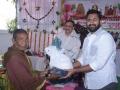 Sri M.Bharat (Geetham Institutes Chairman, Vishakapatnam) distributing saree and rice to poor women  on the occasion of 18thAnniversary of Bheemili Ashram
