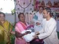 Sri S V Satyanarayana , Vedhantha Institute chairman (Vishakapatnam ) distributing saree and rice to poor women  on the occasion of 18thAnniversary of Bheemili Ashram