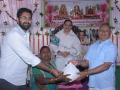 Sri M.Bharat (Geetham Institutes Chairman, Vishakapatnam and Sri S.Veerabhadra Rao , Editor of Visakha Samacharam distributing saree and rice to poor women  on the occasion of 18thAnniversary of Bheemili Ashram