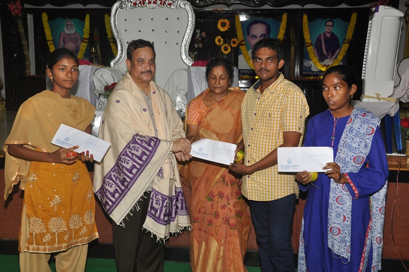 Scholarship provided to merit students by UARDT on the occasion of Guru Pournami