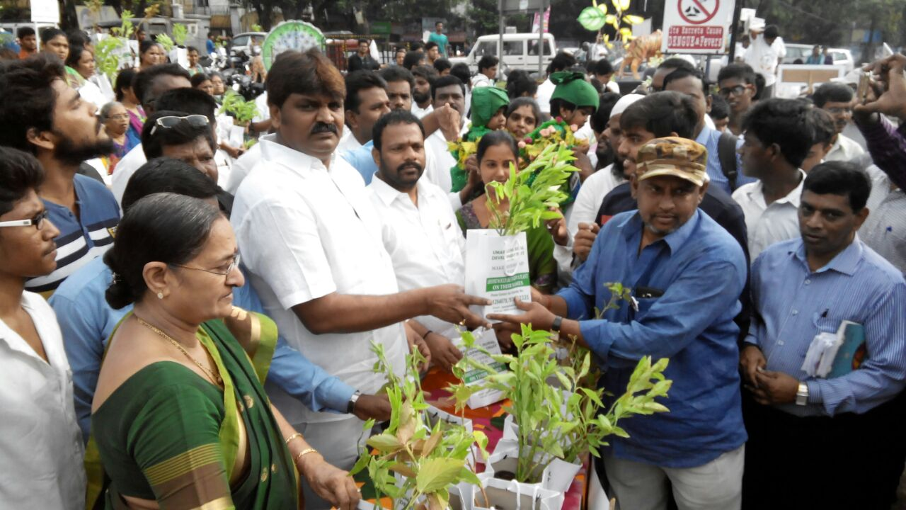 Telangana State Greater Hyderabad Municipal Corporation Mayor Bonthu Rammohan Garu distributing the free plants to the people at KBR National Park through our Trust UARDT. Biodiversity Director also participated in the program.